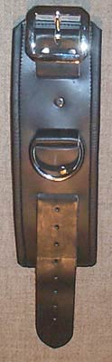 black leather shackles with black trimmed edges