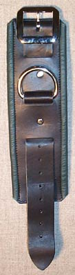 black leather shackles with green trimmed edges